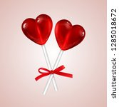 two red heart lollipops with a... | Shutterstock .eps vector #1285018672