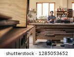 woodworker sitting alone at... | Shutterstock . vector #1285053652