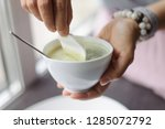 woman puts a cotton pad in a... | Shutterstock . vector #1285072792
