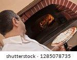 pizza maker pizzaiolo  working... | Shutterstock . vector #1285078735