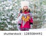 happy caucasian girl in winter... | Shutterstock . vector #1285084492