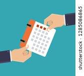 hand holding a calendar ...   Shutterstock .eps vector #1285086865