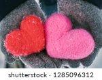hands wearing woolen gloves... | Shutterstock . vector #1285096312