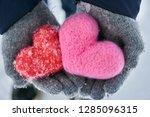 hands wearing woolen gloves... | Shutterstock . vector #1285096315