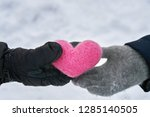 male hand in black mitten gives ... | Shutterstock . vector #1285140505