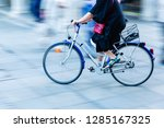 older woman rides a bicycle in... | Shutterstock . vector #1285167325