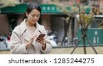 woman using of mobile phone in...   Shutterstock . vector #1285244275