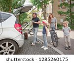 family is packing their bikes... | Shutterstock . vector #1285260175