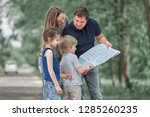 family with their children... | Shutterstock . vector #1285260235