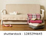 beige sofa with plaid and... | Shutterstock . vector #1285294645