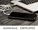 a usb cable connects your phone ... | Shutterstock . vector #1285312042
