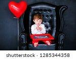 Little Boy Sitting On The...