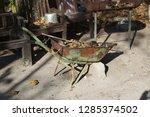 isolated rusted wheelbarrow... | Shutterstock . vector #1285374502