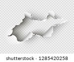 ragged hole torn in ripped... | Shutterstock .eps vector #1285420258