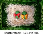 Pair easter green ecology eggs in  natural  wicker basket - stock photo