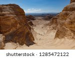 hikers on the trail in the... | Shutterstock . vector #1285472122