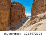 hikers on the trail in the... | Shutterstock . vector #1285472125