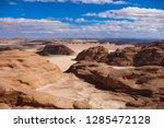 hiking trail in the desert... | Shutterstock . vector #1285472128
