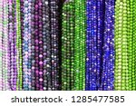 colorful beads background.... | Shutterstock . vector #1285477585