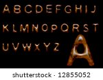 Complete alphabet made of shiny wood texture - stock photo