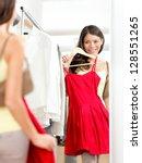 Shopper Woman Trying Clothing...