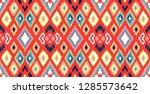 ikat geometric folklore... | Shutterstock .eps vector #1285573642