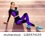 girl sportsman crossfit and... | Shutterstock . vector #1285574155
