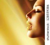 luxury golden makeup. beautiful ... | Shutterstock . vector #128559386