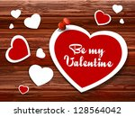 paper hearts on a wooden... | Shutterstock .eps vector #128564042