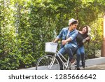 happy couple riding bicycle... | Shutterstock . vector #1285666642