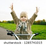 little cute real boy on bicycle ... | Shutterstock . vector #1285741015