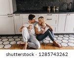 blissful couple drinking coffee ... | Shutterstock . vector #1285743262