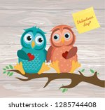 a pair of cute owlet sitting on ...   Shutterstock .eps vector #1285744408