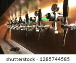craft beer keg system machine for many type of IPA or pale APL lager style at night club bar build in with wooden counter, close up selective focus point, no people