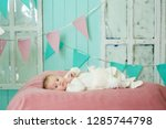 little newborn baby girl lying... | Shutterstock . vector #1285744798