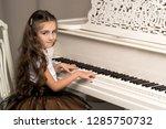 beautiful little girl near a... | Shutterstock . vector #1285750732