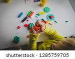 child playing with clay molding ... | Shutterstock . vector #1285759705