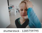 sad stressed little boy with... | Shutterstock . vector #1285759795