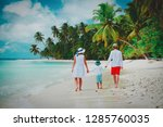 family with child walking on... | Shutterstock . vector #1285760035