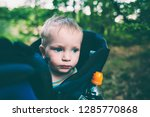 a child is sitting in a... | Shutterstock . vector #1285770868
