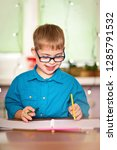 a boy with down syndrome draws... | Shutterstock . vector #1285791532