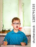 a boy with down syndrome draws... | Shutterstock . vector #1285791535