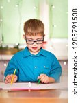 a boy with down syndrome draws... | Shutterstock . vector #1285791538