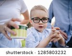 family on a picnic in the... | Shutterstock . vector #1285803232