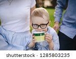 family on a picnic in the... | Shutterstock . vector #1285803235