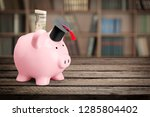 graduation mortarboard on  book ... | Shutterstock . vector #1285804402