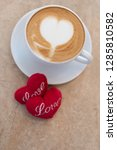hot coffee cup with red hearts... | Shutterstock . vector #1285810582