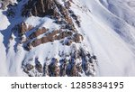 huge rocks covered with snow.... | Shutterstock . vector #1285834195