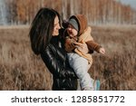 young caucasian mother with a... | Shutterstock . vector #1285851772