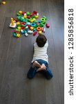 happy baby playing with toy... | Shutterstock . vector #1285856818